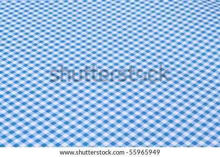 Blue and white tablecloth - stock photo