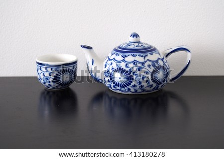 Blue and white tea pot ceramic Chinese style on black table