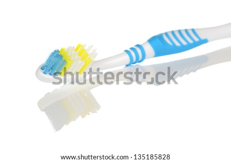 Blue and White Toothbrush with Reflection on White Background - stock photo