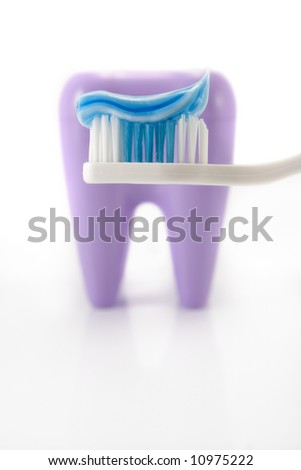 Blue and white toothbrush with teeth isolated on white background