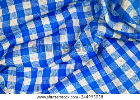 Blue and white wrinkled checkered Bavarian tablecloth pattern texture as Munich Octoberfest background - stock photo