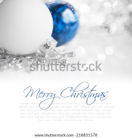 Blue and white xmas ornaments on bright holiday background with space for text - stock photo