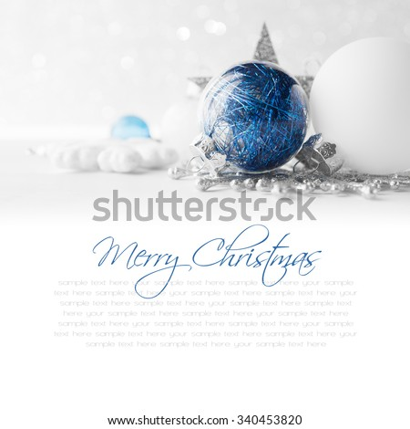 Blue and white xmas ornaments on glitter holiday background. Merry christmas card. Winter holidays. Xmas theme. Happy New Year. Space for text. - stock photo