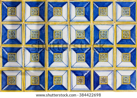 Blue and yellow azulejos on the facade of the old building in Cascais, Portugal.