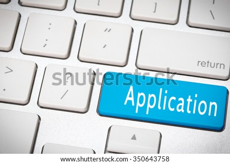 Blue application button on the keyboard - stock photo