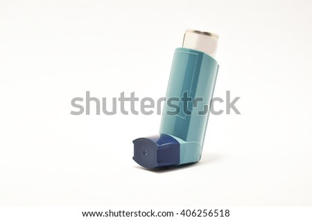 Blue asthma inhaler isolated on white background.