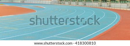 Blue athletics running track, Vintage - stock photo