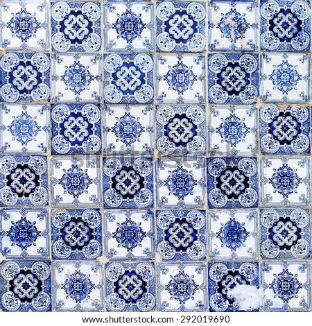Blue azulejos on the building's exterior in Lisbon, Portugal. - stock photo