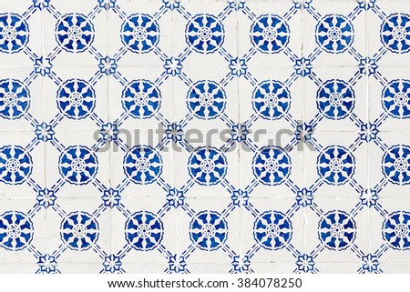 Blue azulejos on the facade of the old building in Alfama district,  in Lisbon, Portugal.