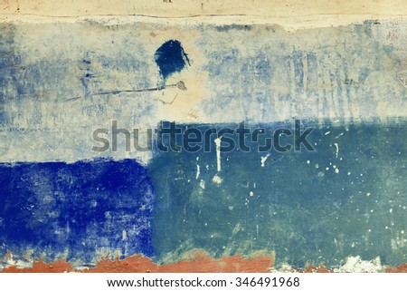 Blue azure abstract brushed traces on concrete wall surface. Vintage effect. - stock photo