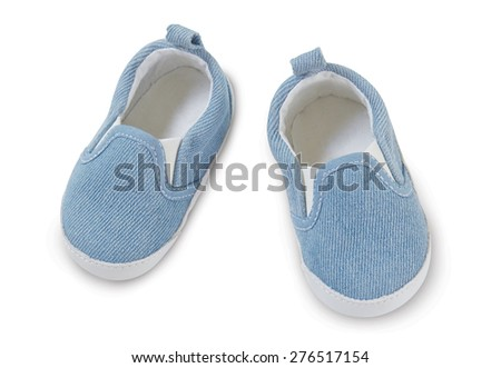 Blue baby slippers on a white background. Top view