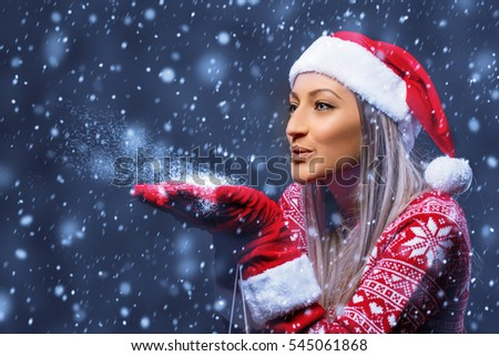 blue background and santa claus woman and snow