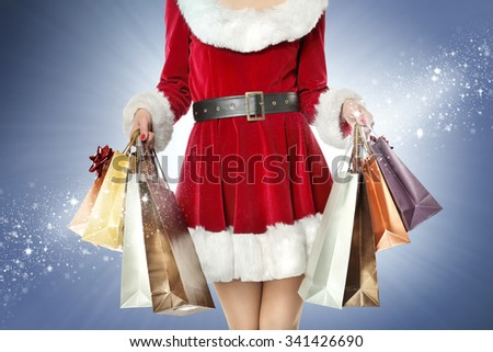 blue background and woman with bags  - stock photo