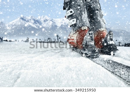 blue background of winter mountains and skis  - stock photo