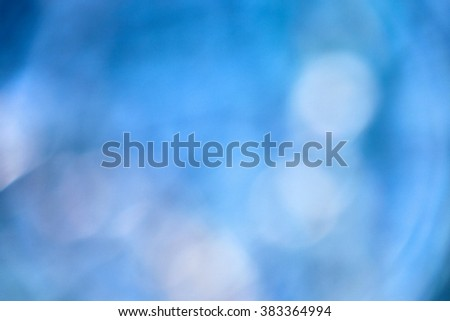 blue background, white bokeh