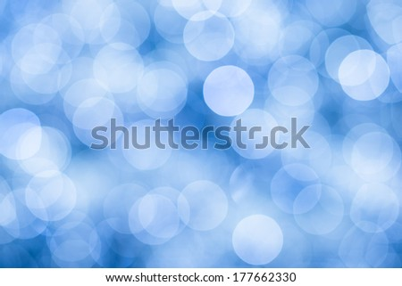 Blue background with bokeh defocused lights, sky colors - stock photo