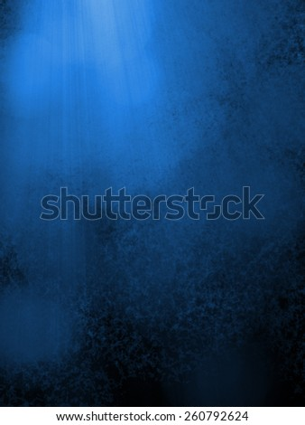 blue background with dark black shadows, soft faint white bokeh lights and rays or beams of light, sunshine coming down from heaven in streaks through the clouds - stock photo