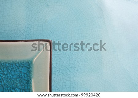 Blue background with plate - stock photo