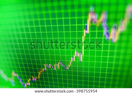 Blue background with stock chart. Analysing stock market data on a monitor. Candle stick graph chart of stock market investment trading. Finance background data graph. Market trading screen.   - stock photo