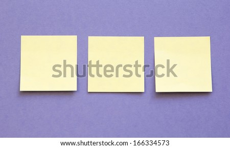 blue background with three blank sticky notes