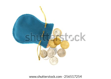 Blue bag with a drop-down coins from different countries - stock photo