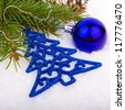 Blue ball on new year's tree. Abstract composition - stock photo