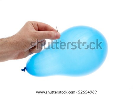 blue ballon  with a needle and a hand - stock photo