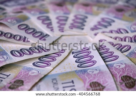 Blue bank notes in the value of one thousand Czech Crowns forming the shape of circle