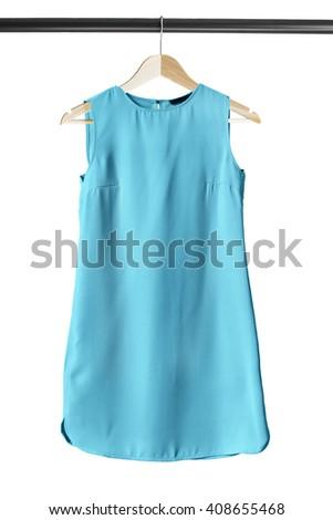 Blue basics mini dress on clothes rack isolated over white - stock photo