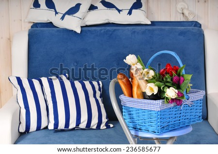Blue basket with flowers and champagne