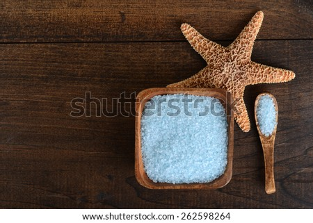 blue bath salts with starfish - stock photo