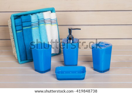 Blue Bathroom Accessories With Blue And White On Wooden Shelf