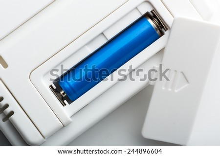Blue battery in the socket - stock photo