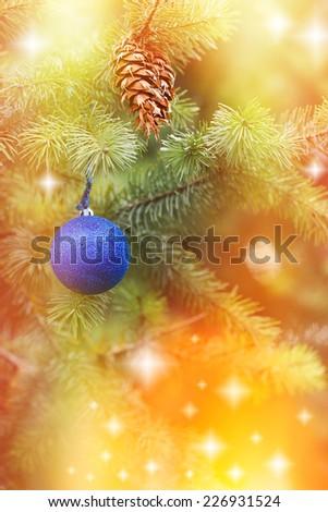 Blue bauble on Christmas tree and Christmas light - stock photo