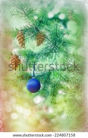 Blue bauble on Christmas tree (xmas ball) - stock photo