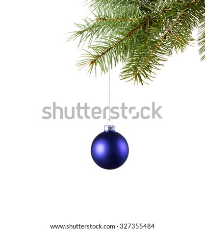 Blue bauble on green christmas firtree on white background