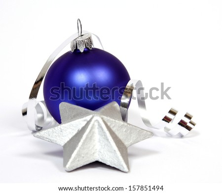 Blue bauble with the silver star the white background - stock photo