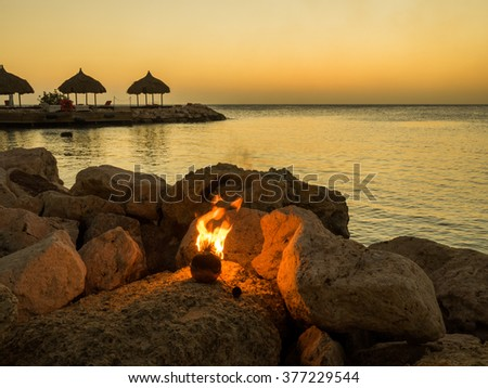 Blue Bay Beach Sunset - On the Caribbean Island of Curacao in the Dutch Antilles - stock photo