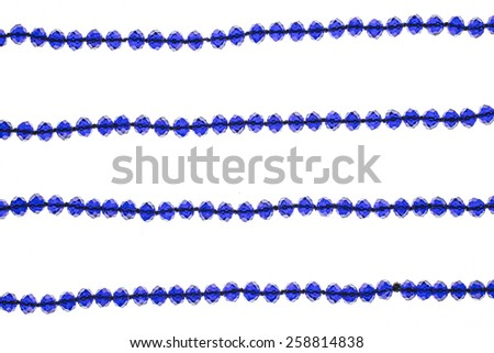 blue beads on a white background
