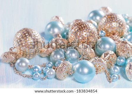 Blue beads on a wooden background closeup - stock photo