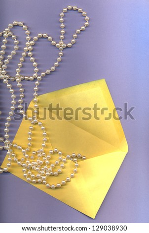 blue beauty background with pearl and envelope - stock photo