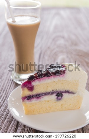 Blue berry cake served on a plate.