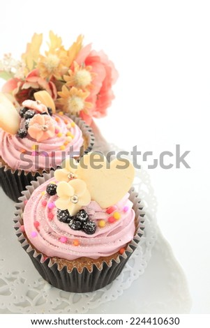 blue berry cup cake and heart shaped cookie - stock photo