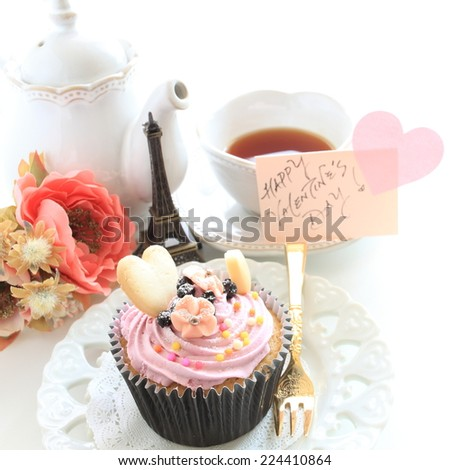 blue berry cup cake and tea with greeting card - stock photo