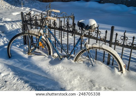 Blue Bike covered with fresh snow in Montreal - stock photo