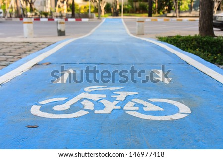 Blue bike lane - stock photo