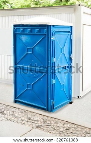 Blue Bio Public Toilet On The Sidewalk - stock photo