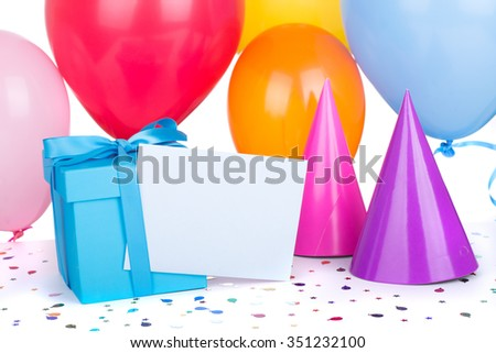 Blue birthday gift box with balloons and party hats