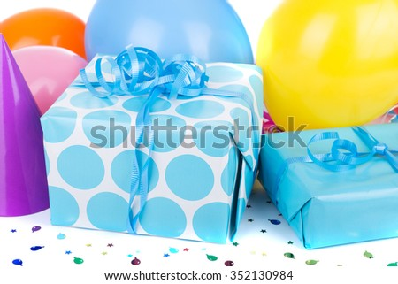 Blue birthday gifts with colorful party balloons - stock photo