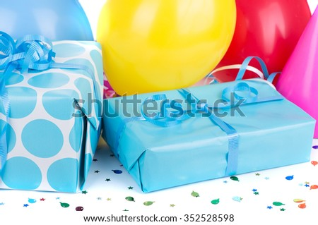 Blue birthday gifts with colorful party balloons